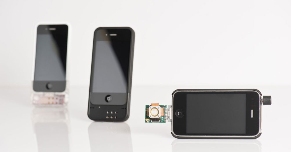 Three stages of an iPhone accessory prototype, photographed by Dotson Studios.